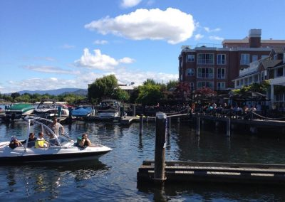 Kelowna Boat Rentals - Boat Driving up to a dock